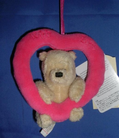 Winnie the Pooh - Holding a Heart on a Ribbon - Gund